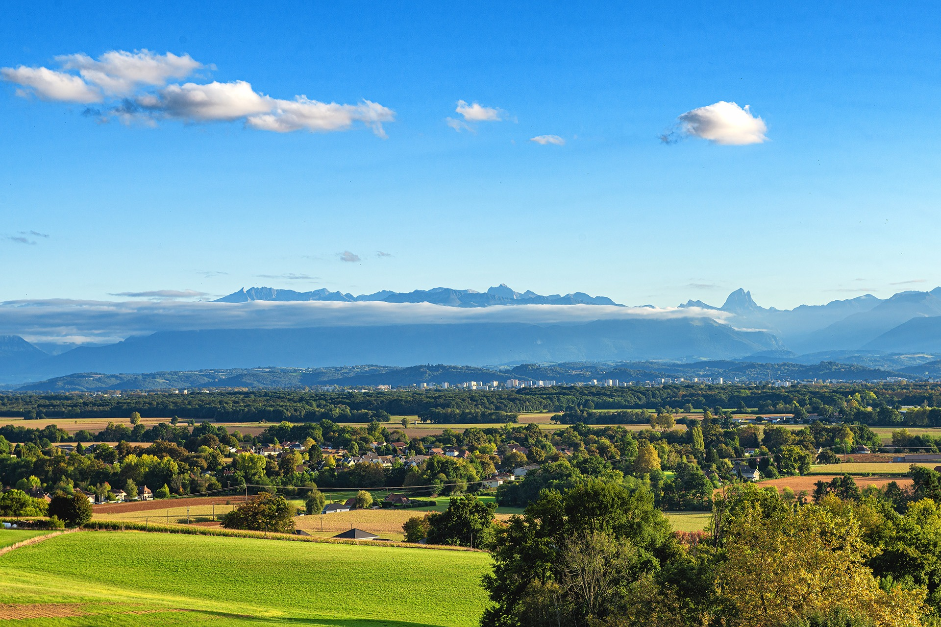 a landscape of Pau city, Pyrenees mountains on background